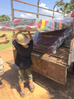 Me helping unload the mattresses we donated.