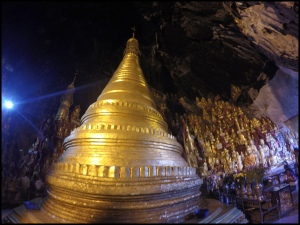 Pagoda inside surrounded by Buddhas