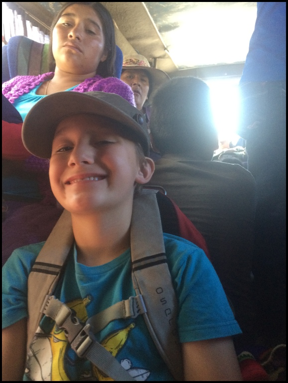 Riding on the crowded bus to hike.