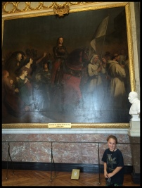 A painting of Joan of Arc leading in battle