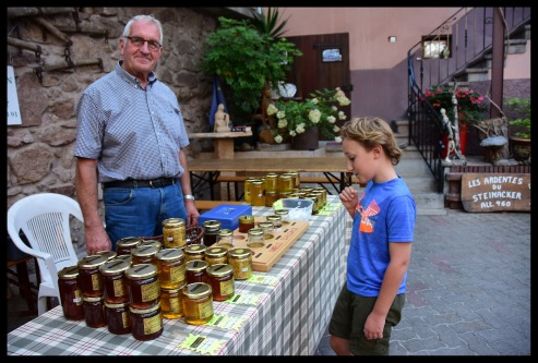 Trying honey at the summer market in Dambach la Ville