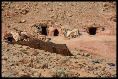 Cave homes of the nomadic Berber family who gave us tea.