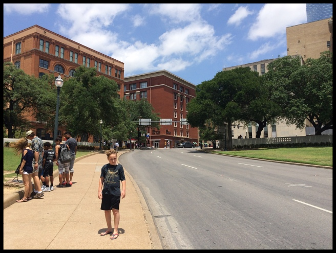 "The building on the left is where Oswald hid and waited to the President's motorcade. The ""x"" on the street on the right was where the first shot hit."